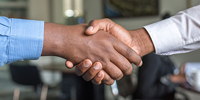 Two African-Americans shaking hands